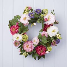Floral Wreath - artificial bright floral wreath. Welcome in the joys of spring with this wondrously joyous floral wreath. Bedecked with feminine artificial flowers and contrasting vibrant greenery, this spring floral wreath would look great hung on a front or back door ready to receive your guests. Or you can hang the floral wreath above a rustic fireplace to ward off the memories of those cold winter nights. affiliate link with noths