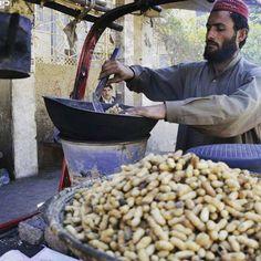 """A vendor roasting peanuts in Quetta"""