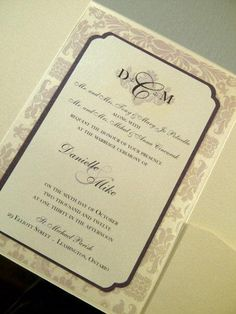 Beautiful Eggplant and Cream wedding invitations with just a touch of damask.  Custom monogram, with  bling accents .   www.youre-invited.ca