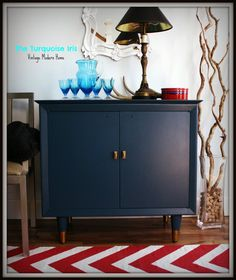 Mid Century Mini Bar in Indigo Blue / Dresser by theTurquoiseIris. Love the bar idea! Also like the wine corks as marbles in the vase.