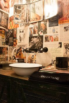 My Houzz: A Garage transformed into a boy's dream pad eclectic-powder-room- In the bathroom van der Velden covered the walls with pages from 1980s Playboy.