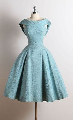 ➳ vintage 1950s dress * blue cotton faille * muslin lining * embossed rose print * dramatic folded collar * metal back zipper * full skirt