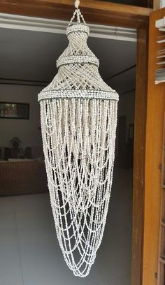 White Nassa Seashell Chandelier Shade Circular (Home Decor or Beach Wedding Decor) Natural White Nassa Shells Approximate Height: 112 cm Approximate Width: 30 cm Shipped from Java, Indonesia Seashell Chandelier, Round Chandelier, Diy Chandelier, Chandelier Shades, Chic Beach House, Beach House Decor, Shell Wind Chimes, Shabby Chic, Boho Bathroom