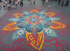 Armed with bags of brightly colored sand, artist Joe Mangrum sprinkles brilliant temporary paintings on the streets of NYC, Chicago, San Francisco and elsewhere. See more of his work on Colossal.  http://www.thisiscolossal.com/2014/02/spontaneous-temporary-sand-paintings-by-joe-mangrum/