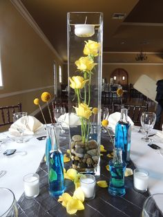 Under water flowers. Tall Cylinder Vases, Tall Glass Vases, Small Vases, Floating Candle Centerpieces, Orchid Centerpieces, Yellow Rose Bouquet, Yellow Roses, Floating Candles Wedding, Pink And White Weddings