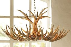 Shop faux antler chandelier from Pottery Barn. Our furniture, home decor and accessories collections feature faux antler chandelier in quality materials and classic styles. Antler Chandelier, Chandelier Lighting, Cabin Chandelier, Antler Lamp, Simple Chandelier, Chandelier Bedroom, Pottery Barn, Eclectic Chandeliers, Eclectic Decor