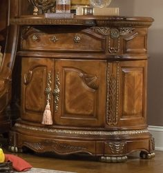 <br />SKU# AI-65040-28<br /><br /><br />Discover elegance in every curve of the Cortina collection. From the graceful lines of its deep carvings to the crowning feature of its marble cameo, every inch of Cortina exudes a stately presence. Sturdy metal footings, beaded glass, and triple marble are design elements that add to Cortina's kinetic appeal.  <br /> <br />Cortina draws its inspirations from the Italian city of Cortina d'Ampezzo, the breathtaking beauty of the mountain ranges, and the…