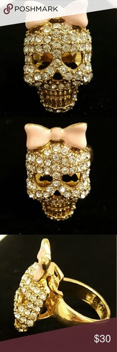 Betsey Johnson Skull Ring Gold colored Betsey Johnson ring cover in rhinestones with a pink bow. Size 7.5 Betsey Johnson Jewelry Rings