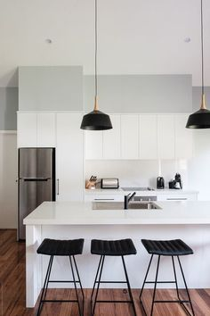 Contemporary kitchen interior by Rowena Naylor for Stocksy United