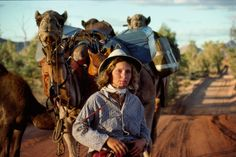 """In 1977, Robyn Davidson walked 1,700 miles across the Australian desert with 4 camels and her dog.  It was documented by National Geographic photographer Rick Smolan.  Their story comes out in theaters as the movie """"Tracks"""" this September, 2014."""