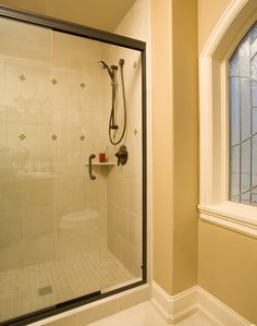 Frameless slider Oil rubbed bronze finish  frameless shower doors for less institutional look.