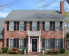 Enter this luxurious two-story brick colonial home and admire the elegant foyer, flanked by the formal dining room and the living room.