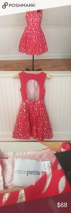 Asos Laser Cut Dress size 4 petite Sold out hard to find! Vibrant red laser cut Asos mini fit and flare dress. Stunning open back! New with tags  ASOS Petite Dresses Mini