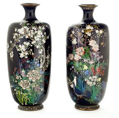 A pair of small cloisonné enamel vases Meiji period (late 19th century) Both of ovoid form with flaring mouth worked in polychrome enamel and silver wire on a midnight blue ground, the first with large peonies under a blossoming prunus, the other with two doves among a profusion of flowers under a cherry tree, both with gilt metal mounts