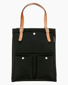 The Toimi bag is both refined and durable. It features two large laptop-sized compartments with a small zip top pocket sandwiched in between. Small odds and ends can be organized inside the three exterior snap pockets. Adjust the leat Canvas Leather, Leather Bag, Marimekko Bag, Thing 1, Beautiful Handbags, Black Tote, Cosmetic Bag, Bag Accessories, Shopping Bag