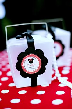 Fun favor boxes at a Minnie Mouse girl birthday party!  See more party ideas at CatchMyParty.com!