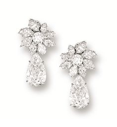 PAIR OF DIAMOND PENDENT EAR CLIPS, HARRY WINSTON.  Each suspending on a pear-shaped diamond weighing 4.10 and 4.00 carats, surmounted by a cluster of marquise-shaped and brilliant-cut diamonds altogether weighing approximately 7.40 carats, mounted in platinum, signed and numbered 5500, pendants detachable.