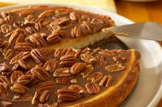 Save for Caramel Topping. A creamy cheesecake recipe topped with sticky caramel, pecans, and a sprinkle of sea salt. Creamy Cheesecake Recipe, Salted Caramel Cheesecake, Pecan Cheesecake, Caramel Pecan, Cheesecake Recipes, Dessert Recipes, Carmel Cheesecake, Caramel Frosting, Classic Cheesecake