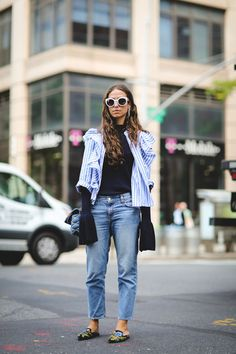 So what if she can't reach across the table at lunch? Those sleeves are giving us life. #refinery29 http://www.refinery29.com/street-style-trends-big-shoulders-disheveled-outfits#slide-2
