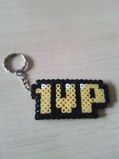 """Porte clé Mario """"1UP"""" de la boutique PixelsMarnia sur Etsy"""