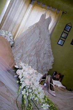You can capture that gorgeous cascade bouquet and your stunning wedding dress in a beautiful photo.   http://www.photographywithheart.com/  #photographywithheart #dress #flowers #wedding #gown #cascade