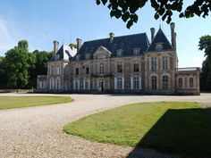French Chateau for sale in 76 - Seine Maritime , Normandy France. This remarkable authentic Château dating from the beginning of the XVII Century is listed as a Monument Historique and has magnificent wooden panelling, imposing stone staircase and other period features. The outbuildings are substantial and include splendid stables dating from the XIXth century, a caretakers lodge, various other dwellings, houses and farm buildings set around a farm courtyard which is actually let. See movie!