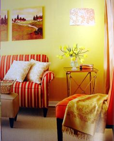 Using warm hues such as red, orange, and yellow makes this room warm and cozy. The different fabrics all mix well together because of the analogous color scheme.