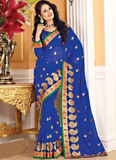 Item :#3675 Shop this product from here.. http://www.silkmuseumsurat.in/charming-blue-chiffon-jacquard-saree?filter_name=3675  Color	 : Blue Fabric	 : Faux Chiffon Occasion	 : Party, Reception Style	 : Contemporary Work	 : Embroidered