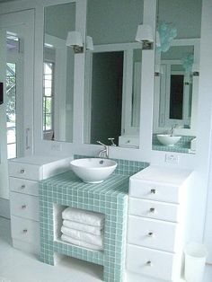 Modern sink ~ I like the detailing of the mirror divided into 3 sections ~ House of Turquoise: Effervescent Bathroom
