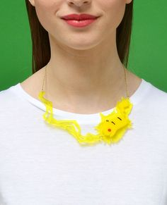 Pikachu, I choose you!!! Pika Pika! Thunderbolt attack! Become the ultimate Pokemon coach with this necklace.  Fluor hand laser-cut acrylicand yellow opaque acrylic, assembled by hand.  Gold plated chain.  Limited to 20 pieces.
