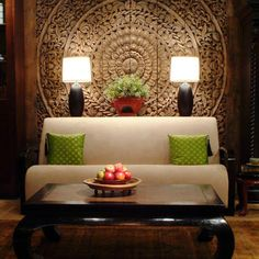 For Drawing room? Asian Living Room by The Golden Triangle- Carved screen works great as a backdrop to this art deco sofa and horse hoof legged coffee table.