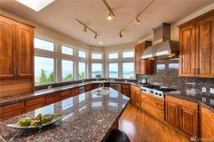 This stunning kitchen boasts amazing views, beautiful details and plenty of counter space and storage.