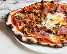 Marta: the brand new and buzzing Nomad pizza restaurant serving dressed up Roman-style pizzas that come thin & crispy. Go for brunch and add an egg | Nomad