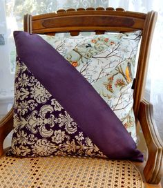 If this pillow isnt awesome then I dont know what is. A mix-match of gorgeous fabrics, cleverly combined into an appealing design that is unique yet