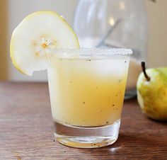 This simple gem of a cocktail is a great fall afternoon delight. Read on to get the scoop on this Vanilla, Pear, and Vodka Cocktail. Ingredients: 12 oz pear juice 6 oz vodka vanilla bean, seeds scraped Vanilla sugar (for rim) 1 cup ice, plus more to ser Beste Cocktails, Cocktails To Try, Holiday Cocktails, Halloween Cocktails, Cocktail Recipes For Fall, Apple Cocktails, Healthy Cocktails, Summer Drinks, Fun Drinks