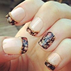 That's a cool idea...French manicure and one finger painted :) maybe in a dog color though :p