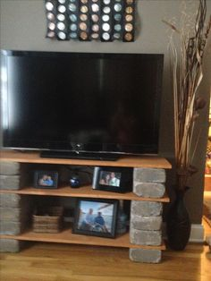 I love my DIY TV stand with landscaping blocks and stained boards.