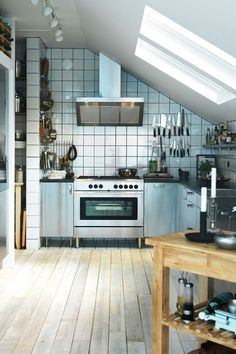 You don't need an industrial sized kitchen to go for an industrial look, but consider softening the stainless steel scheme with wooden floors and furniture.