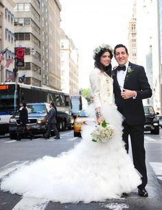 Fashion's favorite man repeller, Leandra Medine and UBS financier Abie Cohen  shared their I-do's with 450 guests in a traditional Jewish ceremony at the St. Regis hotel. True to form, Medine wore a Marchesa gown, a custom-made Rebecca Minkoff motorcycle jacket, a peony and lily crown, and bedazzled platform Superga sneakers. -- Photograph by Shedrin & Rubi Photographers