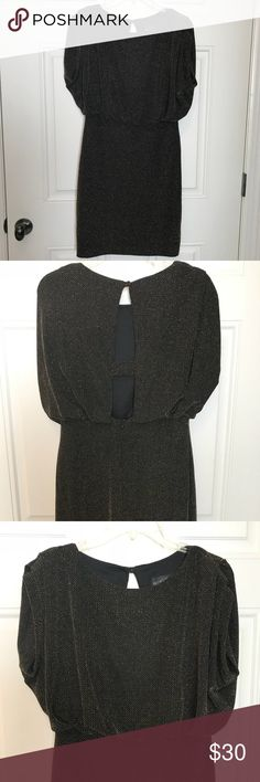 """Betsy & Adam dress Evening dress in excellent condition. The brand is a Betsy & Adam and it is a size 6. The dress is a sparkly black and gold. The total length from top of shoulder to bottom is 36"""". Betsy & Adam Dresses"""