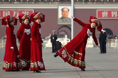 Beijing — Hostesses pose as they take souvenir photos at Tiananmen Square, near the Great Hall of the People where the annual National People's Congress is held.     PHOTOGRAPH BY: ANDY WONG / ASSOCIATED PRESS