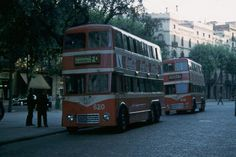 Then-new double-deck trolleybus no. 620 on route FD and trolleybus 610 on route FC at the terminus, Barcelona. [8] These were of a class of 27 chassis model 9651 made by BUT in England with bodies built in Barcelona by Material y Construcciones. In 1964 they were re-bodied as single deck. In 1968, 24 of them were sold to SALTUV of Valencia.    Photographed on  1956-08-28