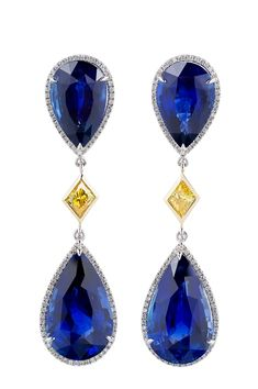 Natural Sapphire and Fancy Diamond Earrings.  Four natural Sri Lankan sapphires in the amount of 46.29 cts. t.w. are featured in these drop earrings, spaced with 0.99 ct. t.w. fancy-shap...