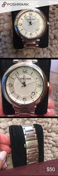 Silver Michael Kors watch with mother of pearl Silver watch with white interior and mother of pearl face. Perfect everyday watch purchased from Bloomingdales. Minor scratching typical from wear, no major damage. Priced to sell.  Extra links included Michael Kors Accessories Watches