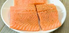 seasoning salmon with salt pepper and Cajun seasoning Barbecue Dinner Recipes, Supper Recipes, Salmon Recipe Videos, Salmon Recipes, Seafood Recipes, Salmon Seasoning, Cajun Seasoning, Cabbage And Smoked Sausage, Whole 30 Crockpot Recipes