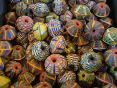 africa- Maybe you could make paper beads but use thread or wire to make these stripes