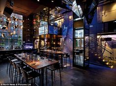 Projectors inside the dining hall of the NYC restaurant can cast different lighting and images onto the walls meaning the room can change am...