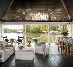 """We ditched convention, thinking outside the box in this lakeside getaway with a """"party dock"""", climbing wall, and upholstered nooks.#HeatherGarrettInteriorDesign#design #lakehouse #home#contemporary #style"""
