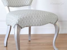 super description on how to re-cover a chair like this - and isn't the silver leaf on the legs lovely?