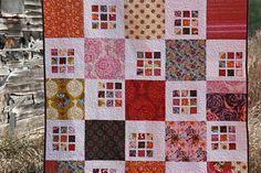 Adorable.  Innocent Crush Quilt  http://www.filminthefridge.com/2011/02/07/an-anna-maria-horner-rubiks-crush-quilt/